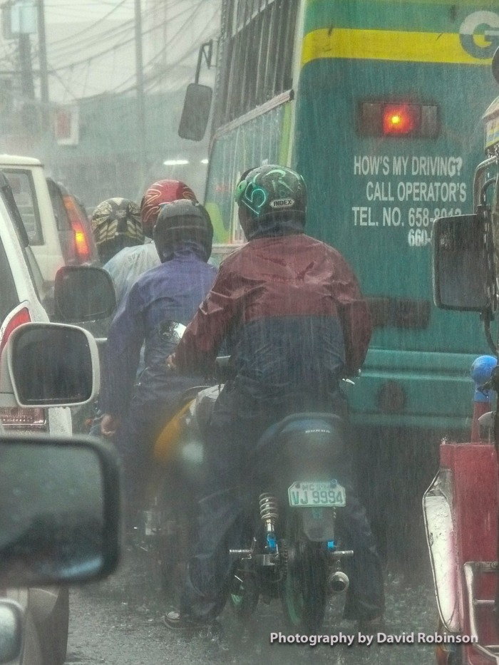 Sun or rain, motorcycles in the Philippines continue on their way. Traffic? Just drive between iit, no matter what.