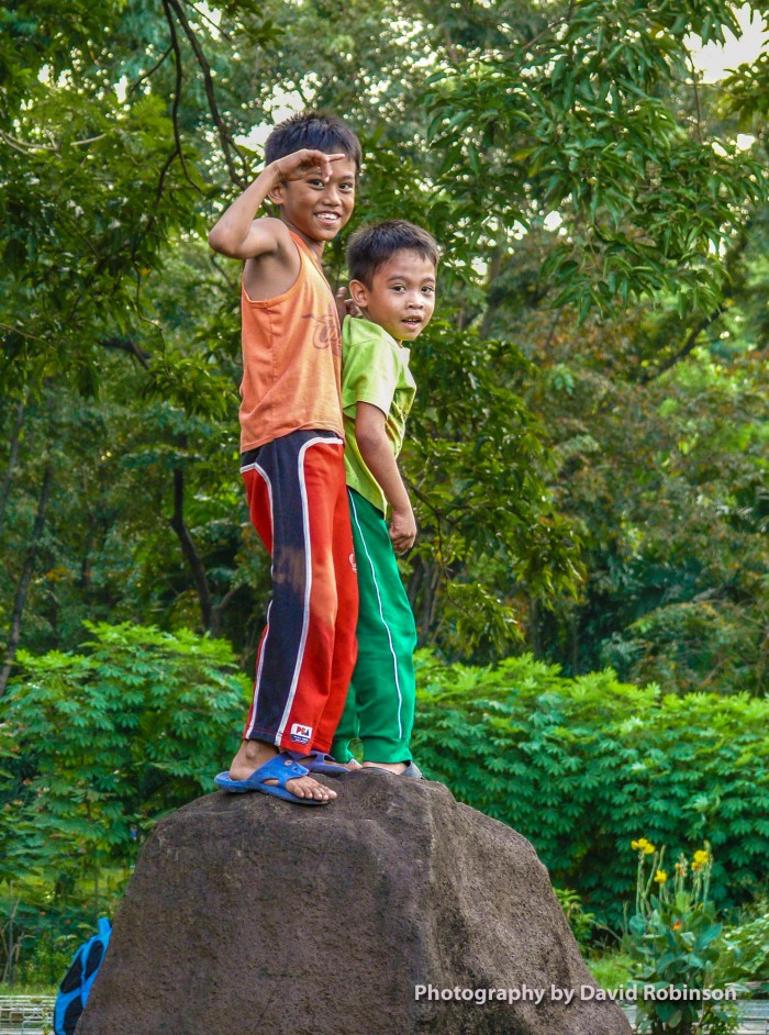 This photo taken at the chinese park area of Rizal Park in Luneta. I was some distance away and saw these two playing on the rock. Even shooting with a telephoto they saw me and happily posed with big smiles. Notice how the older brother has a strong grip on the younger so he doesn't fall off.